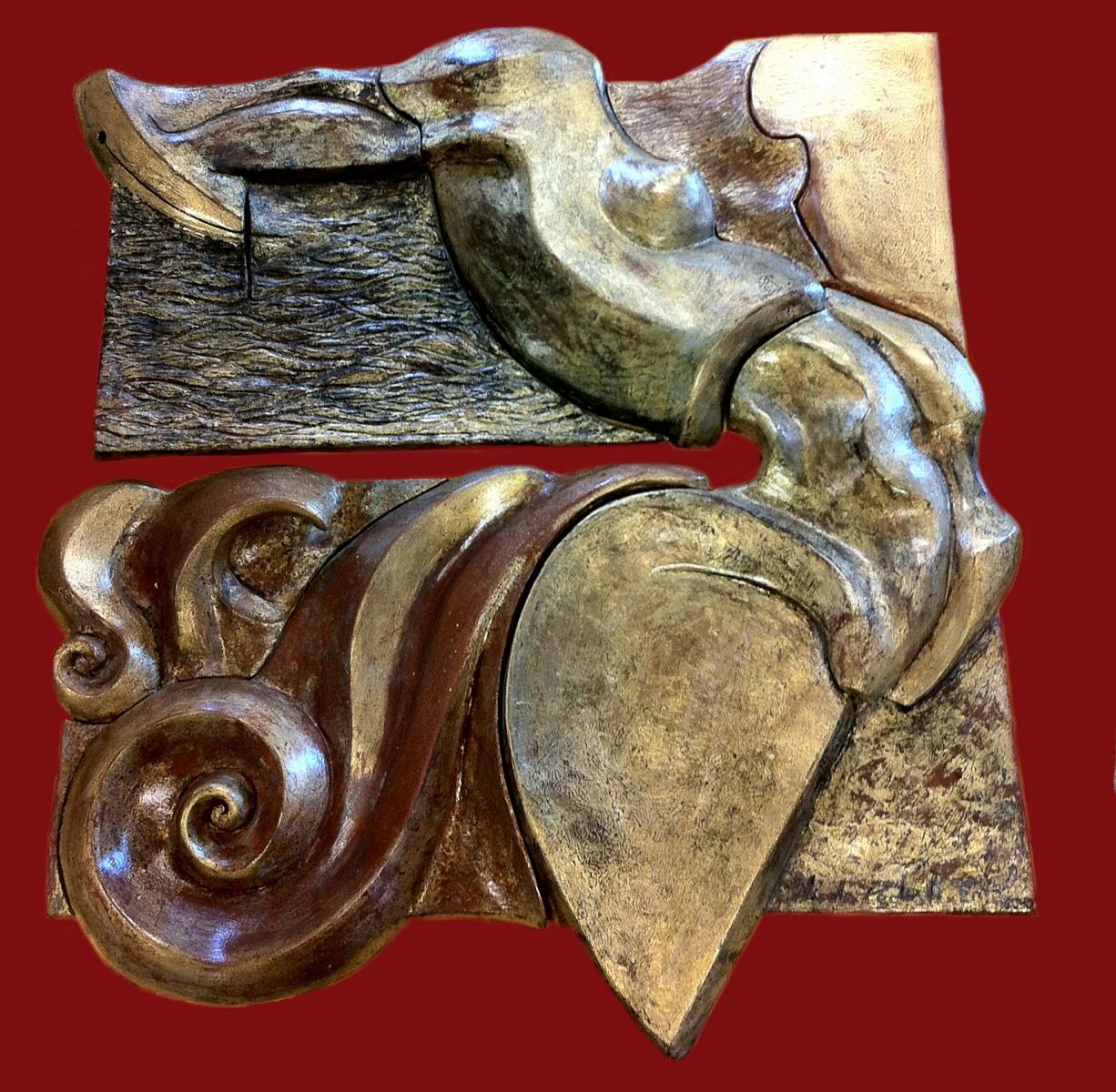 Lorelei-  terracotta patinata e foglia oro- rilievo 2012